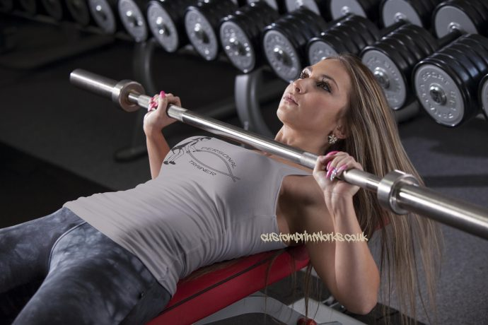 Womens personal trainer vest with woman with battle ropes vest in grey