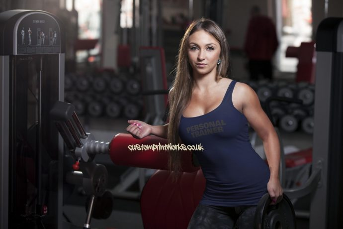 Womens personal trainer vest black personal trainer navy blue on white vest