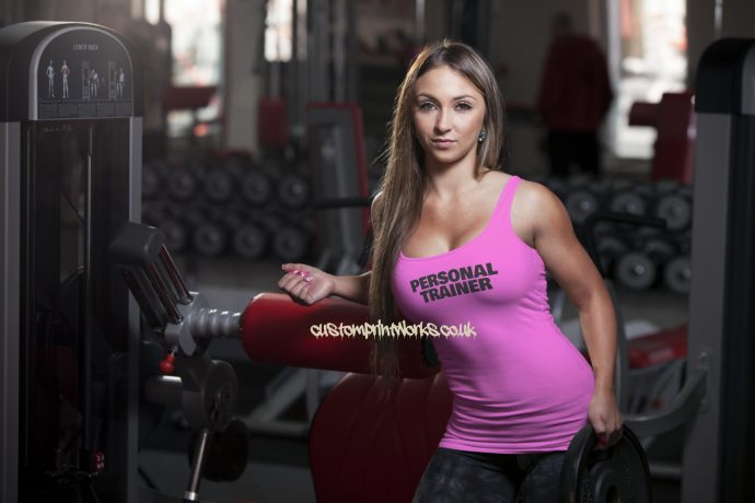 Womens personal trainer vest black personal trainer text on pink vest
