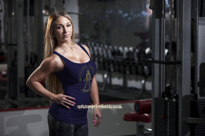 navy blue personal trainer vest with woman holding a barbell