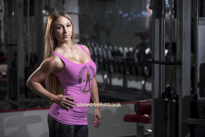 pink personal trainer vest with woman holding a barbell