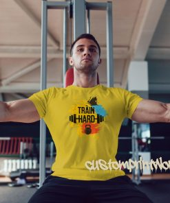 yellow train hard gym t-shirt with kettlebell and barbell