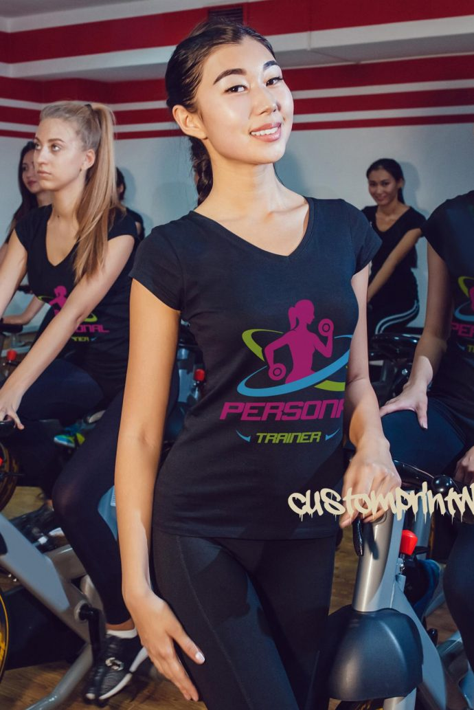 Personal trainer t-shirt in navy blue with green, pink and purple logo