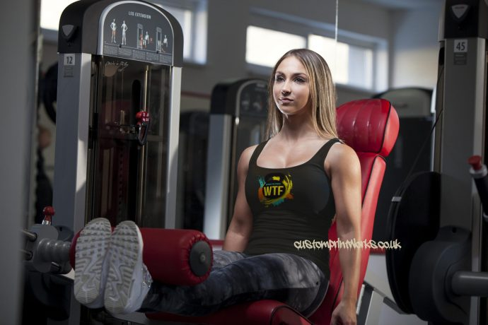 black Ladies gym vest with black kettlebell logo with text Witness the fitness