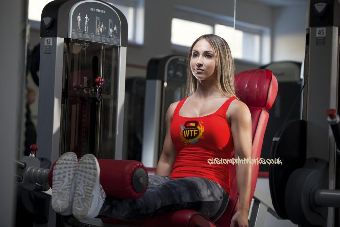 red Ladies gym vest with black kettlebell logo with text Witness the fitness