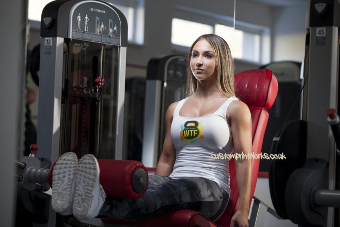 White Ladies gym vest with black kettlebell logo with text Witness the fitness